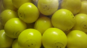Smiley face gumballs are cool--fake smiles may not be